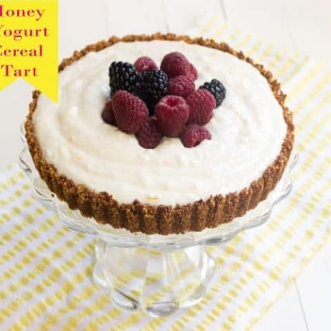 Berry Yogurt Cereal Tart on a cakestand