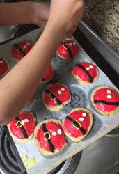 cookie sheet of santa belly sugar cookies