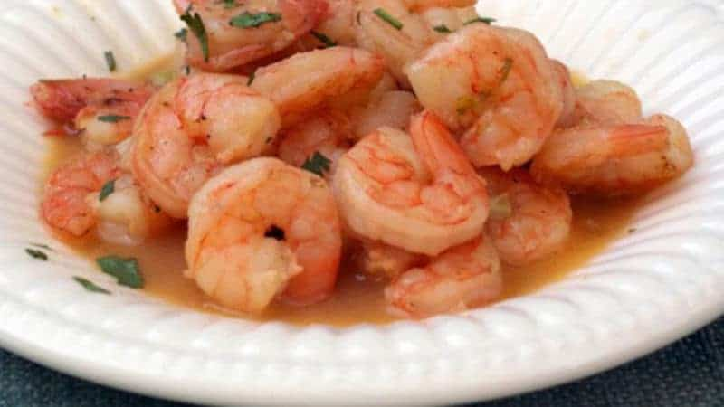 bowl of shrimp scampi with beer