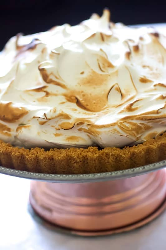 Close up view of Chocolate S'mores Tart topped with a toasted marshmallow meringue.