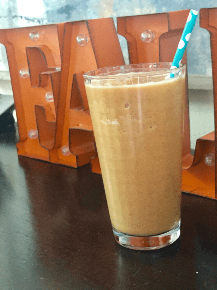 glass filled with Pumpkin Spice Protein Shake.