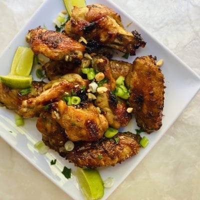 Plate of baked sweet and spicy chicken wings