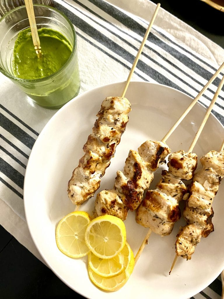 plate of grilled lemon chicken skewers