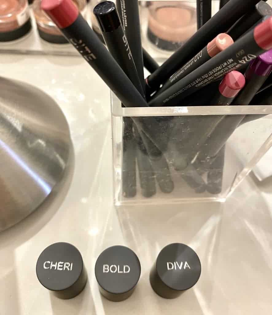 three custom lip lab lipsticks on a counter at the Lip Lab in Los Angeles