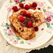 Flowered china plate with raspberry balsamic chicken