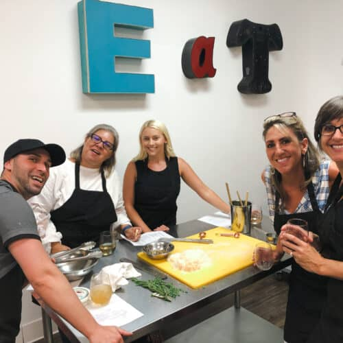photo of a Team competing in Adventures in the Kitchen Chopped Team Building Challenge